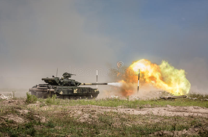 Weaponry and military equipment of the armed forces of Ukraine. KHARKIV REG., UKRAINE - Aug 23, 2015: Training shooting from the tank. Weaponry and military stock photos