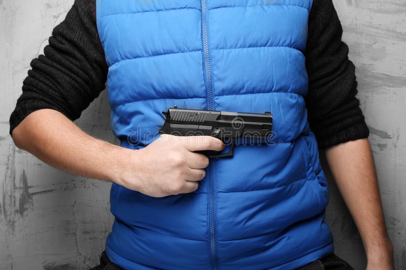 Weapons in male hand for protection against aggression, assault and robbery stock images