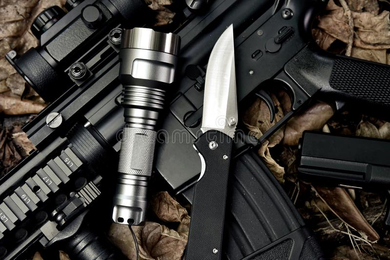 Weapons and military equipment for army, Guns tactical flash light and pocket army knife. Weapons and military equipment for army, Guns tactical flash light and stock photo