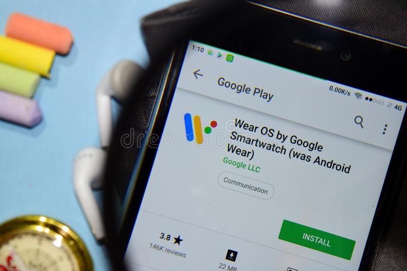 Wear OS by Google Smartwatch was Android Wear dev app with magnifying on Smartphone screen. stock image