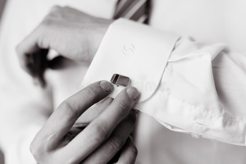Wear a shirt and cufflinks. Men wear a shirt and cufflinks stock photos