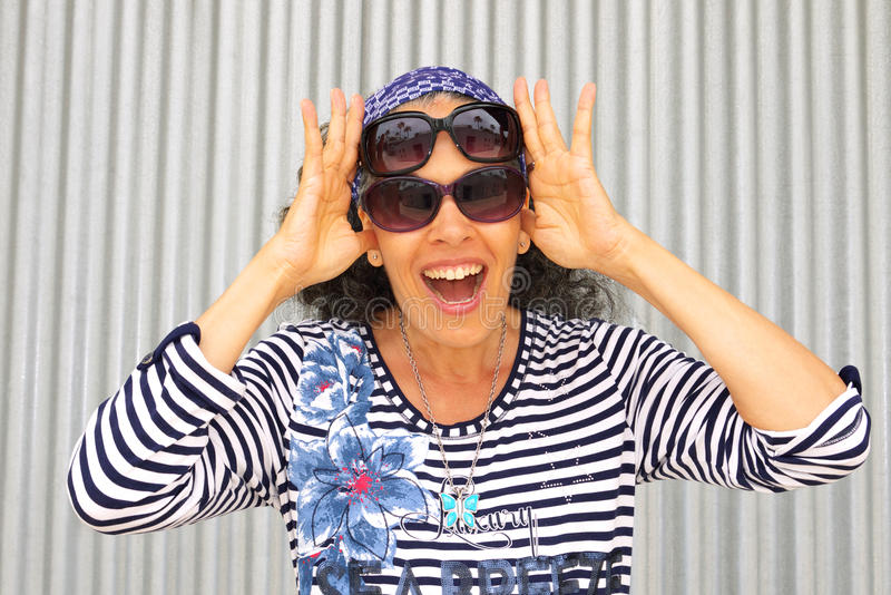 Happy woman with two Pairs Sunglasses stock images