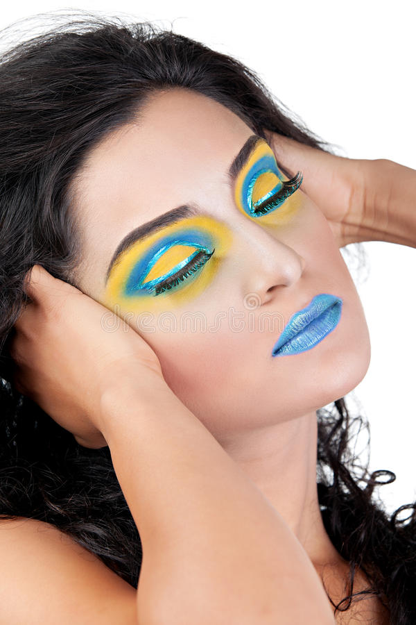 Wearing blue and yellow makeup stock photography