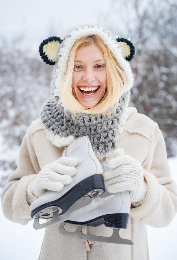 Wearing funny hat plaid scarf and coat. Winter holiday. Christmas. Beautiful woman walking in winter park and feeling stock photos