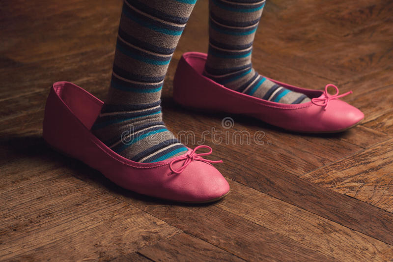 Wearing mama shoes royalty free stock image