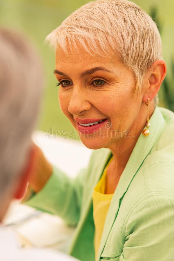 Woman wearing nice earrings looking at husband stock images