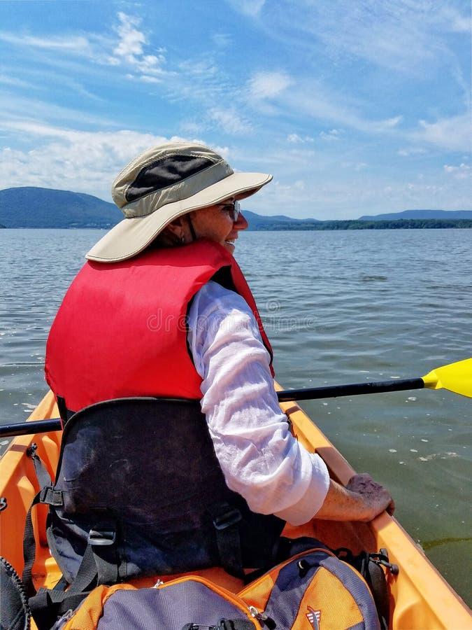 Woman Kayaking on the Hudson River stock photography