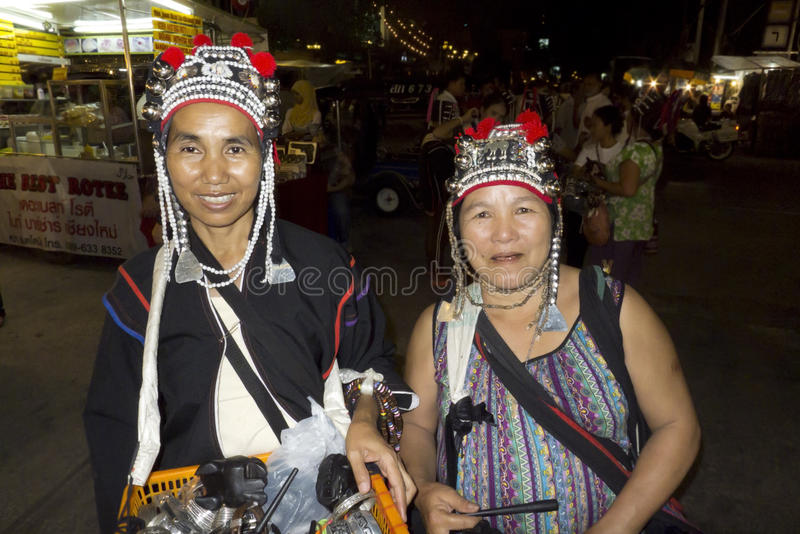 Wearing traditional clothing in Thailand. Chiang Mai, Thailand, 25-May-2011: Two women wearing traditional head garments in Chiang Mai stock photo