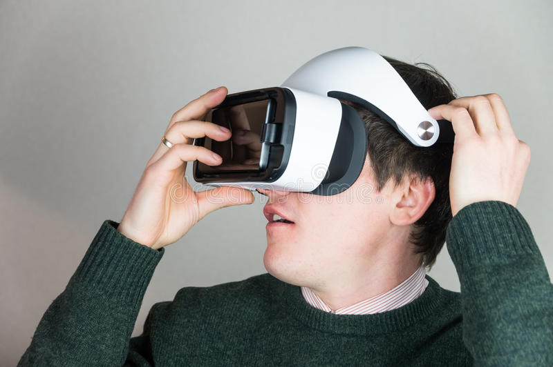 Wearing virtual reality glasses stock photos