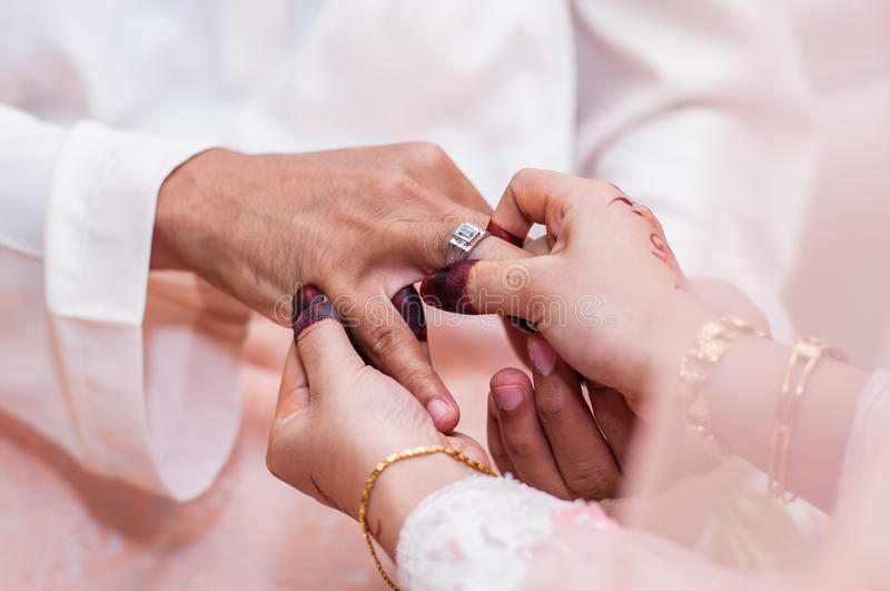 Wearing The Wedding Ring Stock Images