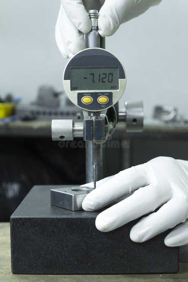Digital Measuring Table : Wearing white glove use digital dial gauge measurement