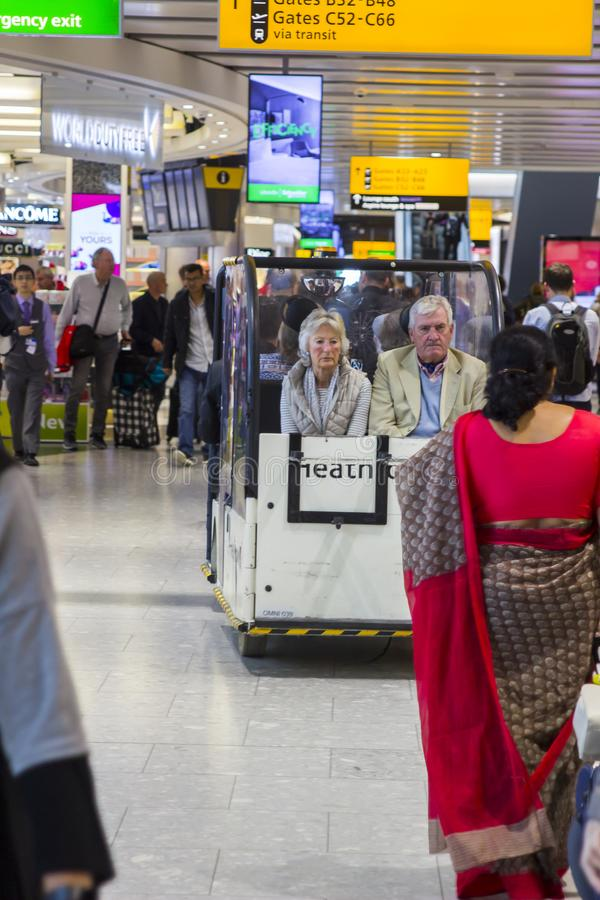 Weary looking passengers in a small people carrier at Heathrow Airport royalty free stock photo