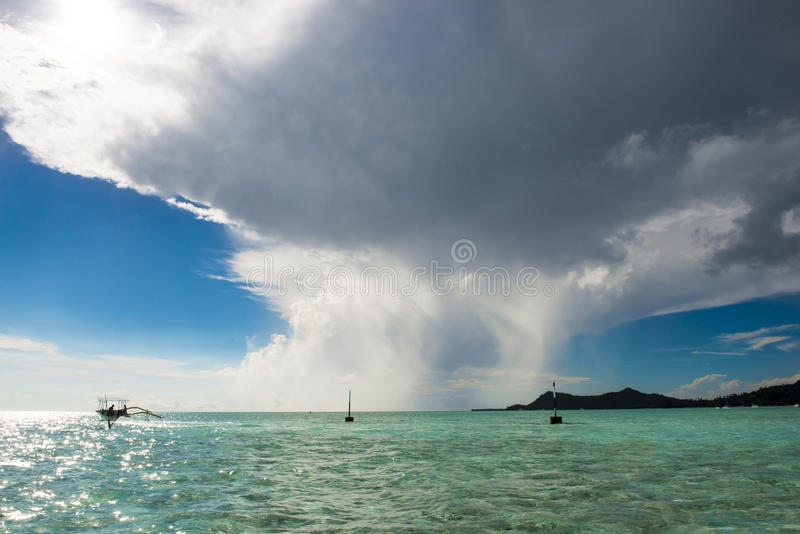 Cumulonimbus clouds over turquoise South Pacific Ocean, Bora Bora stock image