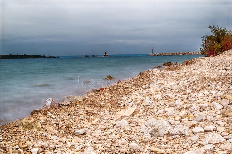 Dark moody weather approaching the rocky beach on Mackinac Island. The weather is dark and moody as it approaches this rocky beach on Mackinac Island royalty free stock photo