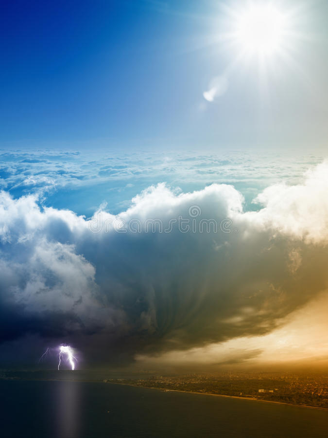 Weather forecast concept, climate change concept. Weather forecast concept - variety weather conditions, bright sun and blue sky, huge thunderbolt struck seaside stock images