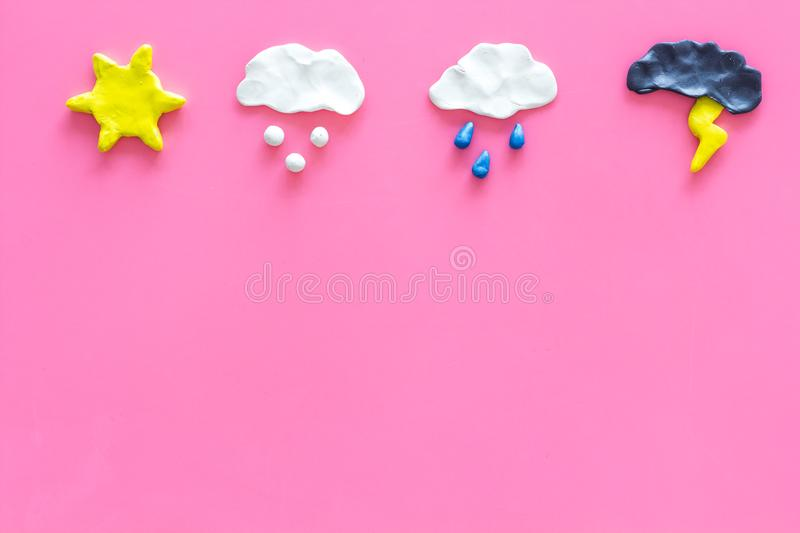 Weather forecast concept. Modern weather icons set on pink background top view copy space. Weather forecast concept. Modern weather icons set on pink background royalty free stock photos