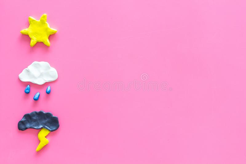 Weather forecast concept. Modern weather icons set on pink background top view copy space. Weather forecast concept. Modern weather icons set on pink background royalty free stock photo