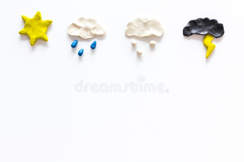 Weather forecast concept. Modern weather icons set on white background top view copy space. Weather forecast concept. Modern weather icons set on white royalty free stock images