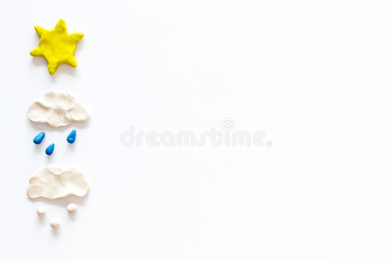 Weather forecast concept. Modern weather icons set on white background top view copy space. Weather forecast concept. Modern weather icons set on white stock image