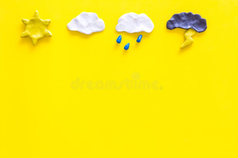 Weather forecast concept. Modern weather icons set on yellow background top view copy space. Weather forecast concept. Modern weather icons set on yellow royalty free stock image