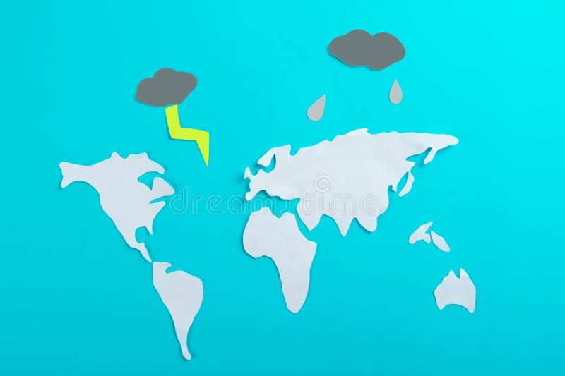 Weather forecast concept. World map and rain clounds royalty free stock photography