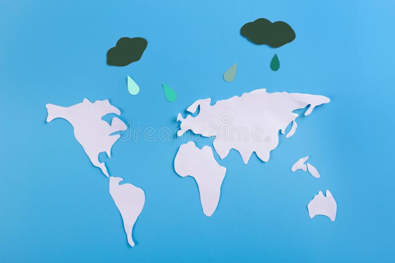 Weather forecast concept. World map and rain clounds royalty free stock images