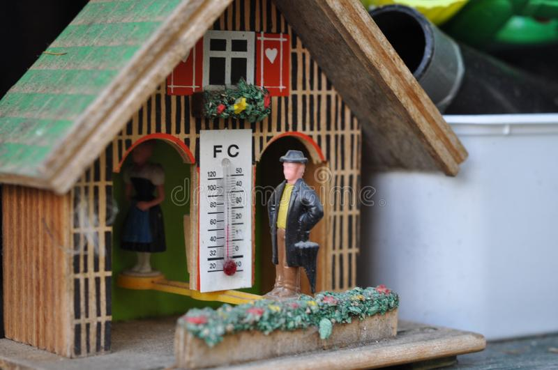 Weather house with temperature stock image