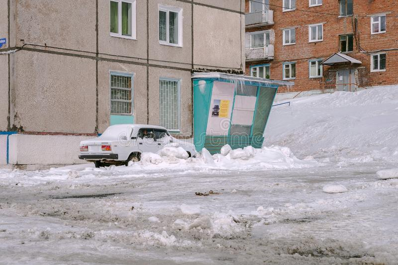 Car are covered with snow, near to the house. stock photography