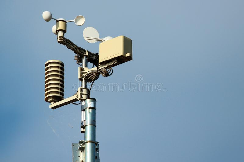 Weather station instruments against blue sky background.  stock photo