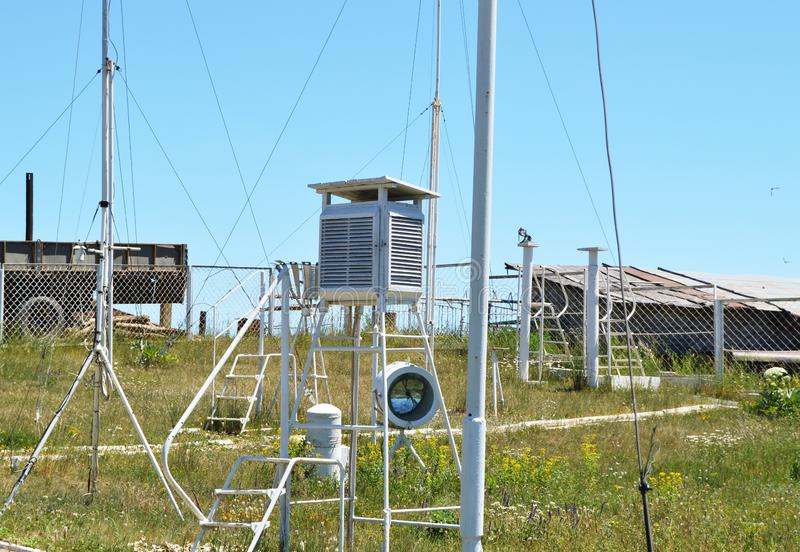 Weather station at the top of the mountain against the blue sky and grass on a Sunny summer day stock images