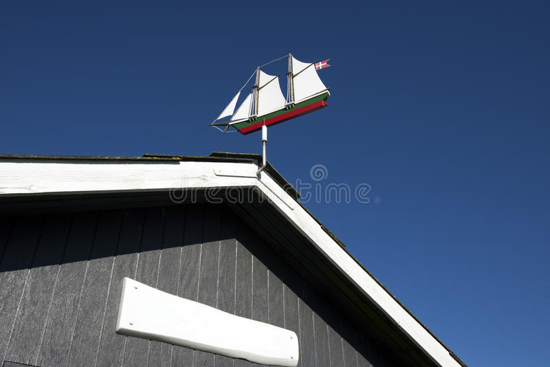 Weather vane as an old sail ship. Against a blue sky on Mano Island, Denmark stock photo
