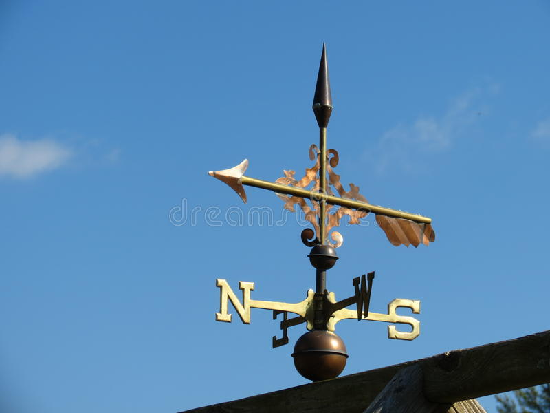 Weather Vane. Atop an wooded structure royalty free stock photography