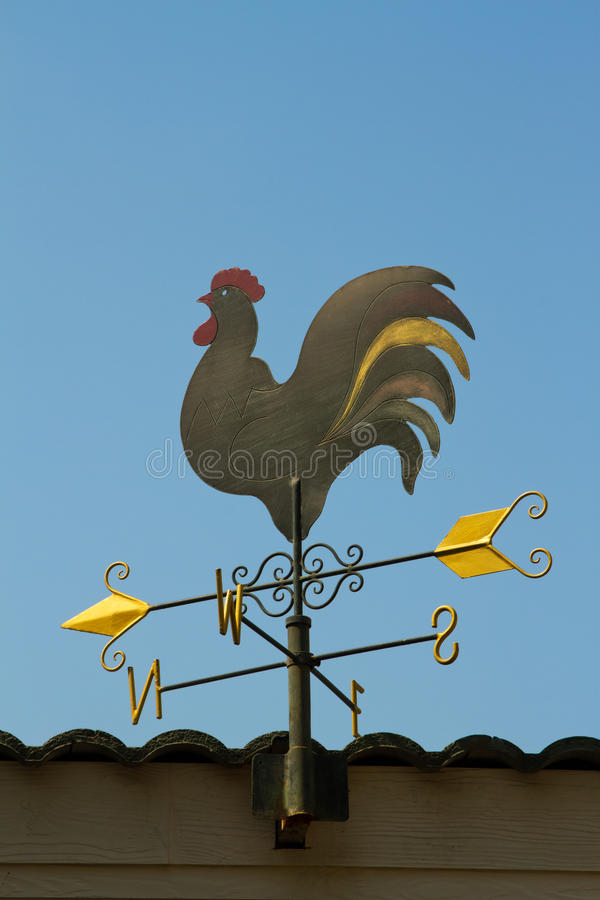 Weather vane in blue sky. Weather vane against a blue sky stock photos