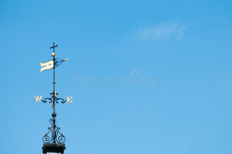 Weather vane in clear blue sky. Showing the wind direction royalty free stock photography