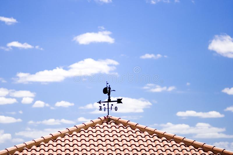 Weather vane with clouds royalty free stock photography