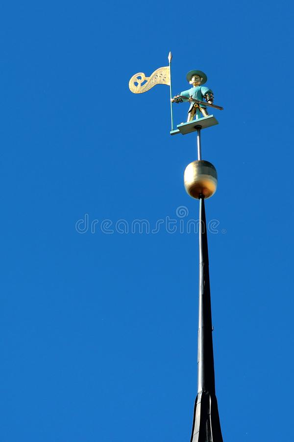A weather vane at old town of Tallinn, Estonia. TALLINN, ESTONIA - JULY 7, 2017: A weather vane figure of old warrior called Old Thomas, on top of the spire of stock photo