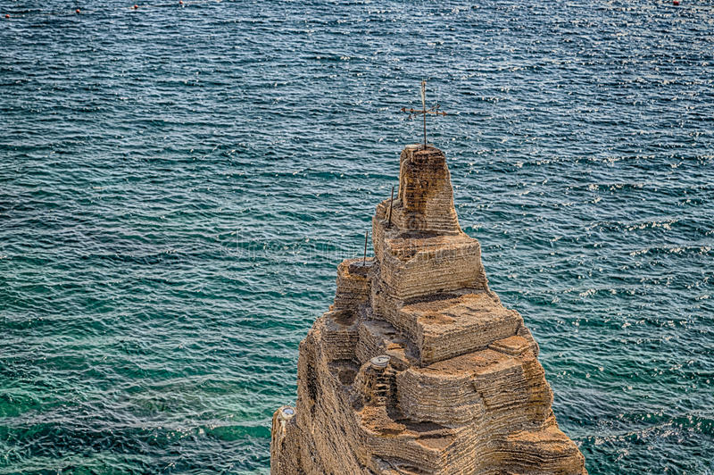 Weather vane on the Salento coast. Rocks and weather vane of the coast of Salento of the Ionian Sea in Italy, in Santa Cesarea Terme, Lecce, Apulia stock image