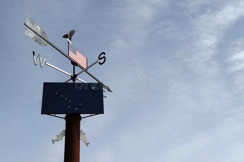 Weather vane. A weather vane set against an open Western American sky stock images