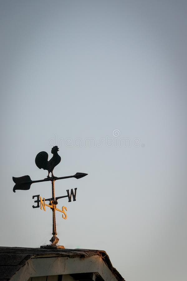 Weather vane in the cold, winter wind at sunset royalty free stock images