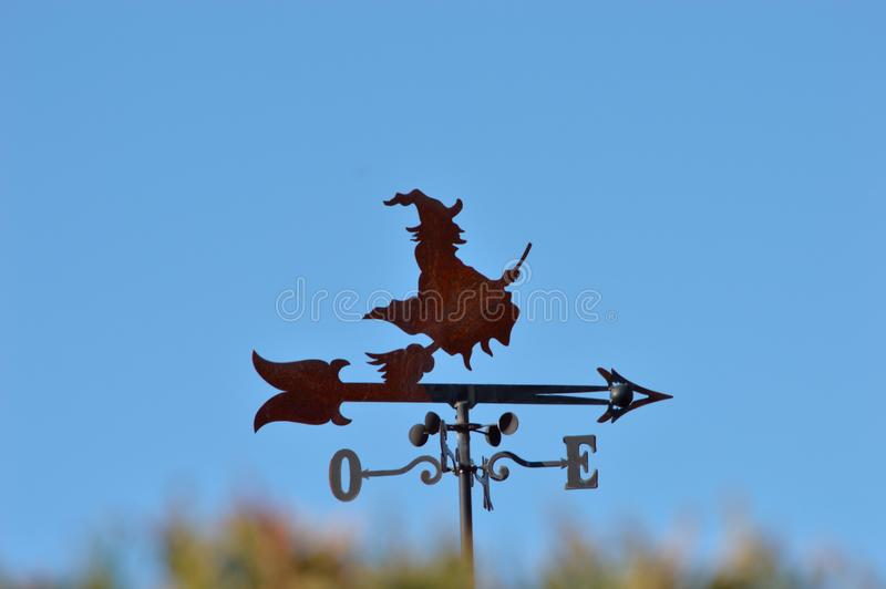 Weather vane with a witch flying with broom stock images