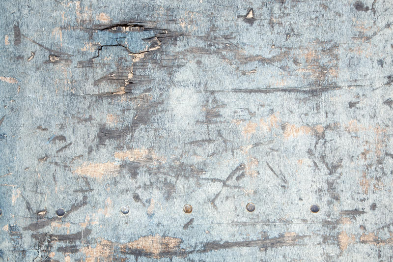 Weathered board with old blue paint and bolts stock photography