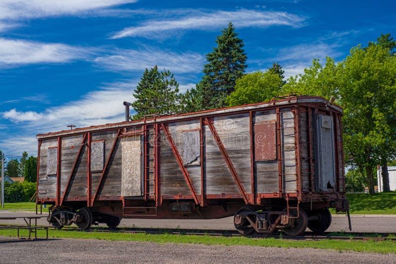 Weathered boxcar, onamia. A weathered boxcar rests near the onamia historic train depot, onamia, minnesota stock photography