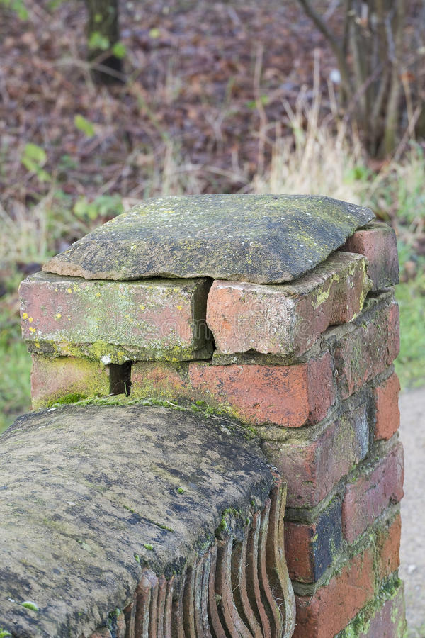 weathered brick wall showing cracks and missing mortar stock photos