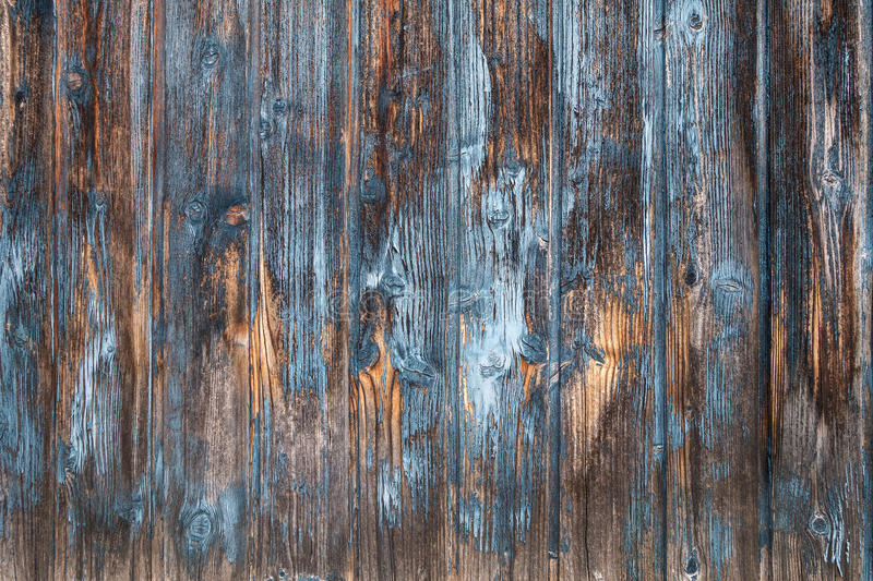 Weathered brown and blue wooden facade stock photo