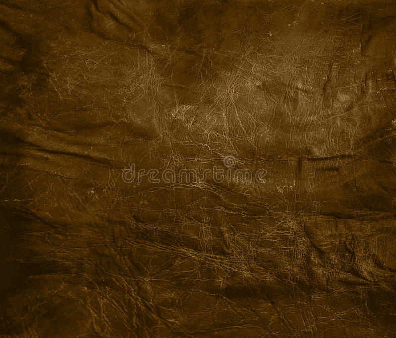 Weathered brown leather background. Faded brown leather background with wrinkles stock photos