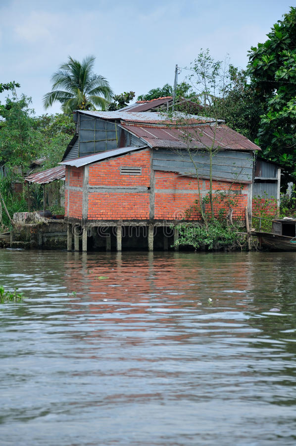 Weathered building on the Mekong River stock photography