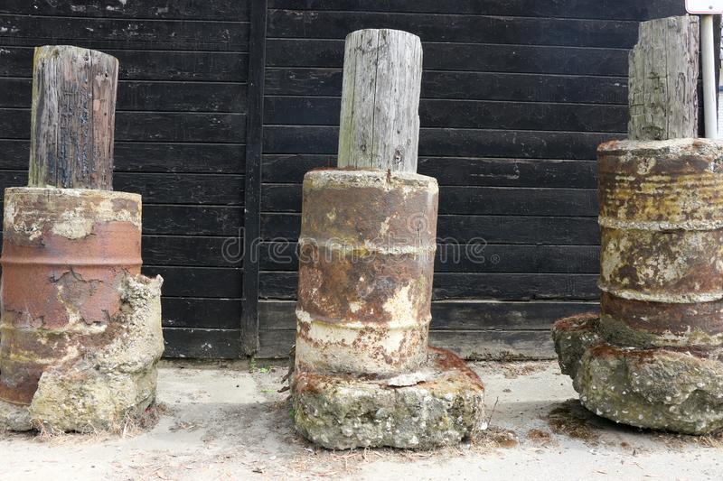 Weathered concrete, metal and wood pylons. royalty free stock photo