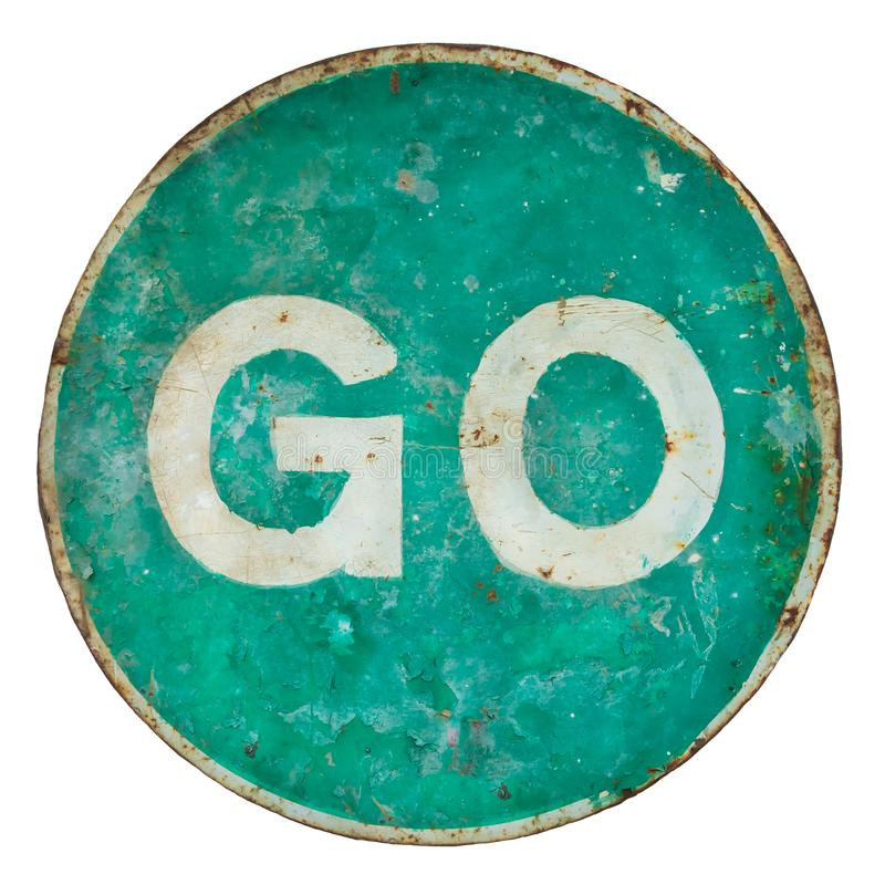 Weathered damaged green road sign with the text go stock photography