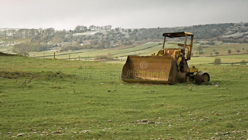 Weathered Digger On Hills Stock Photos