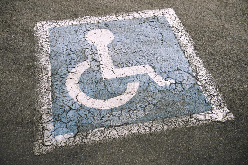 Weathered Disabled Sign in Parking Lot stock image